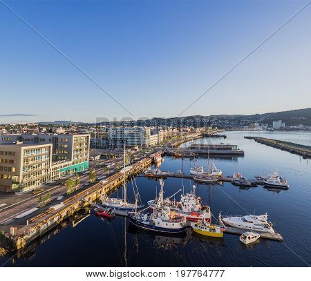 The Brattor Quay in downtown Trondheim Norway with fishing vessels and yachts moored.