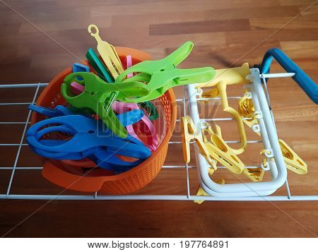 Still image of colorful laundry clothespin / pegs and accessory for ease of hanging