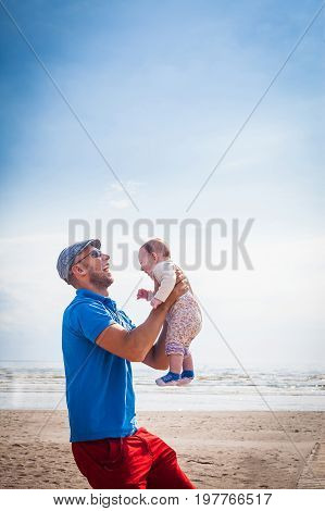 Happy Smiling Father Holding Baby