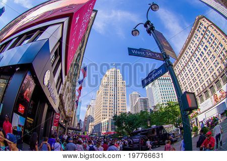 NEW YORK, USA - JUNE 22, 2017: Unidentified people walking in Broadway street and enjoying the beautiful city of New York surrounding with skyscrapers and gorgeous buildings in New York City USA, fish eye effect.