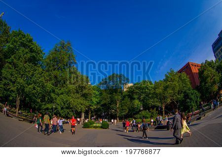 NEW YORK - JULY 22, 2017: Unidentified people enjoying the summer day in the Washington Square Park in New York, Usa, fish eye effect.