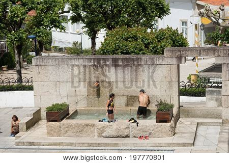 Luso Portugal - 5/14/2017: Couple taking a dip at Luso's mineral waters spa pool