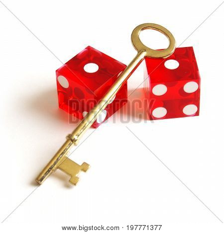An isolated set of red dice with a brass skeleton key for use as a design element with various concepts.