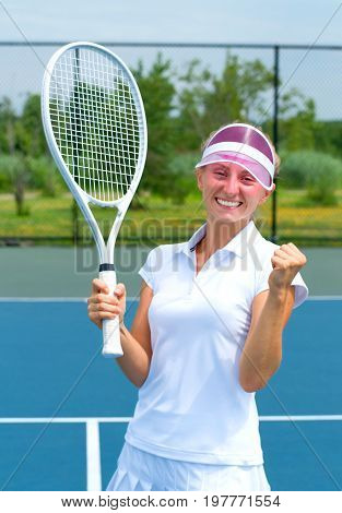 Tennis Player Celebrating After Winning A Tennis Match. Young Woman Is Playing Tennis