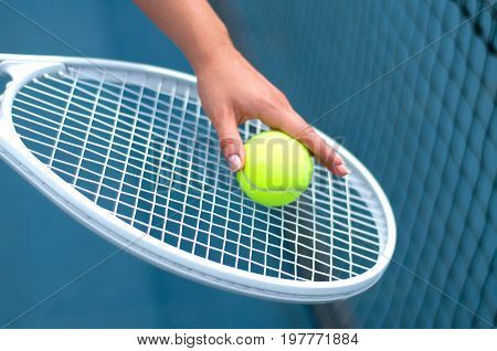 Tennis Racket. Player Holding Tennis Ball In Hand  On The Tennis Court