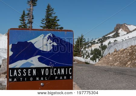 Lassen Volcanic National Park July 1 2017: Lassen Volcanic Scenic Drive sign along the road in early summer