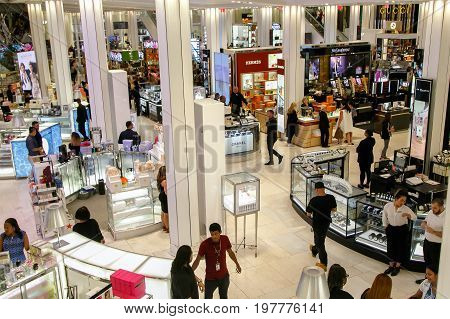 New York July 27 2017: The scene of the cosmetics floor of Macy's department store as customers and employees interact.