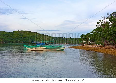 Traditional boats in lagoon of Coron Island Palawan province Philippines. Scenic view from the water on Coron Island landscape.