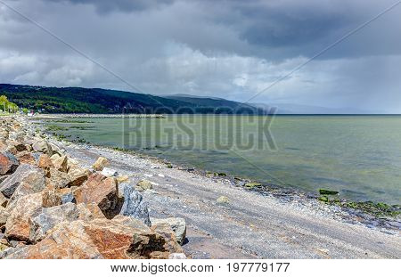 Stormy Sky And Saint Lawrence River Beach In Saint-irenee, Quebec, Canada In Charlevoix Region