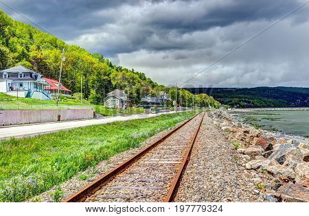 Railroad with Saint Lawrence river in Saint-Irenee Quebec Canada in Charlevoix region