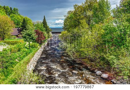 Saint Lawrence river with inland creek in Saint-Irenee Quebec Canada in Charlevoix region