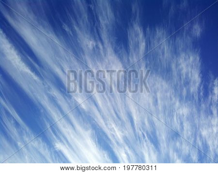 Man stride through deep on dramatic clouds background