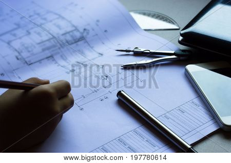 Divider pencil pen ruler image photo bigstock divider pencil pen ruler glasses and smartphone and blueprint on table top malvernweather