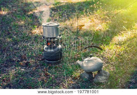 Cooking food on a gas burner. Picnic outdoor