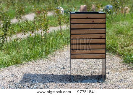 Wood trash bin in the park save nature concept related