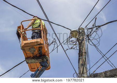 Worker Installs New Cables On An Electric Pole