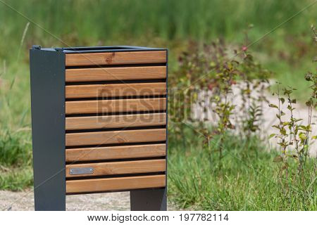 Wood trash bin in the park save nature concept related front view