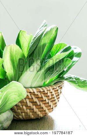 close up Fresh baby green bok choy in basket