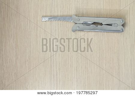 Metall Multi Tool On Wooden Background