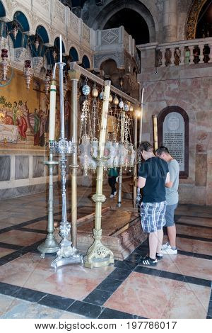 Jerusalem Israel July 14 2017 : Believers pray at the entrance to the Church of the Holy Sepulchre in Jerusalem Israel.