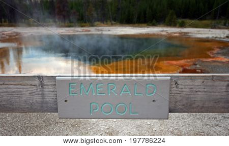 Emerald Pool hot spring sign in the Black Sand Geyser Basin in Yellowstone National Park in Wyoming USA