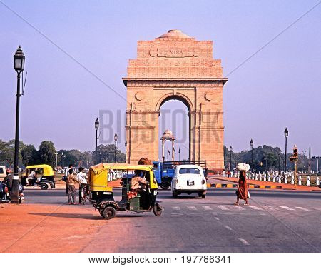 DELHI, INDIA  NOVEMBER 20, 1993 - View of India Gate with local people and traffic in the foreground Delhi Delhi Union Territory India, November 20, 1993.