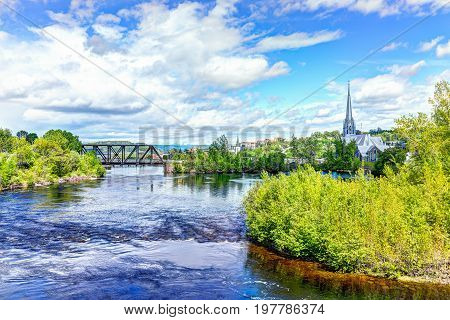 Saguenay, Canada - June 3, 2017: Cityscape Or Skyline Of City In Quebec With Chicoutimi River And Wa