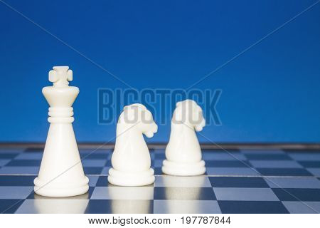 Chess As A Business. A White Figure Controls Two White Horses.