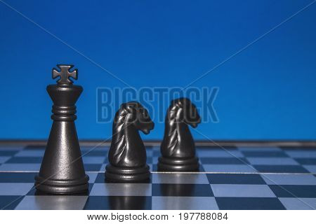 Chess As A Business. A Black Figure Controls Two Black Horses.