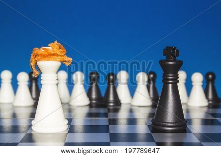 Chess As A Policy. A Lone White Figure With Red Hair Against A Lonely Black Figure. The Public Looks
