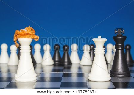 Chess As A Policy. A Lone White Figure With Red Hair Against The White And Black Figures. The Public