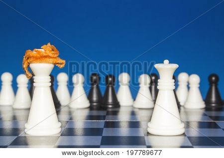 Chess As A Policy. A Lone White Figure With Red Hair Against A Lonely White Figure. The Public Looks
