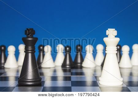 Chess As A Policy. A Lonely Black Figure Against A Lone White Figure. A Large Group Of The Public Lo