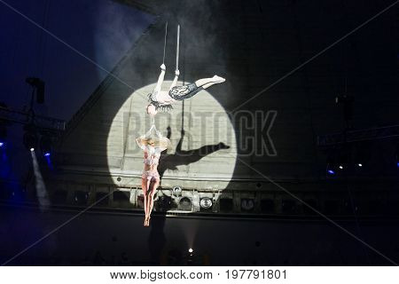 Stunt aerialists men and women in the circus. Love, danger, and romance concept. poster