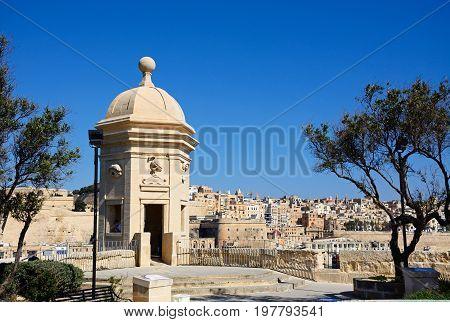 SENGLEA, MALTA - MARCH 31, 2017 - View towards Valletta seen from the Gardjola Gardens with a bastion in the foreground Senglea Malta Europe, March 31, 2017.
