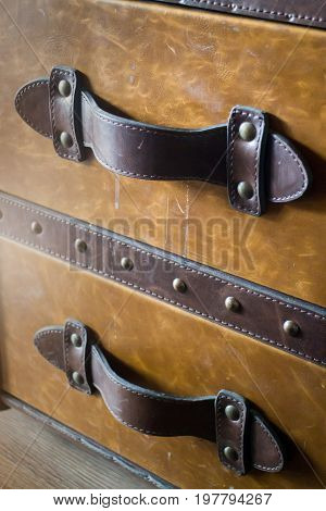Vintage brown leather suitcase up close stock photo