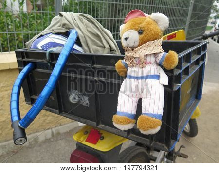 Teddy bear going for a ride on moped in Andalusian Village