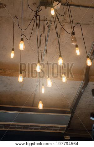 Antique light bulbs hanging on the ceiling stock photo