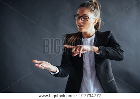 woman showing open hand palm with copy space for product or text.
