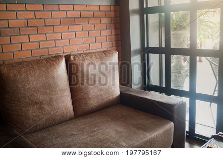 Vintage living room interior with brown sofa stock photo