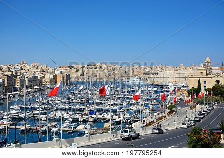 VITTORIOSA, MALTA - MARCH 31, 2017 - Elevated view of Vittoriosa waterfront and marina with views towards Senglea and Valletta Vittoriosa (Birgu) Malta Europe, March 31, 2017.