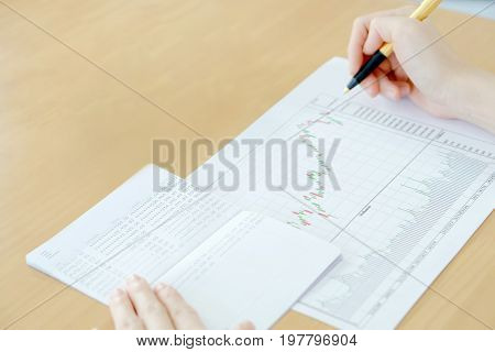 Businesswoman summary report and financial analyzing concept