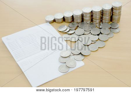 The passbook and coins, saving, money, finance