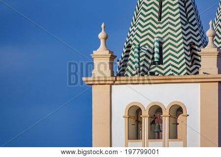 Long shot view of church belfry in Angra do Heroismo with sky in the background, Island of Terceira in Azores, Portugal