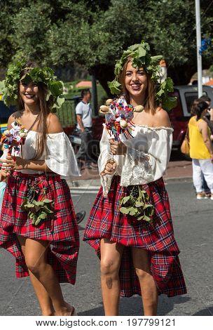 ESTREITO DE CAMARA DE LOBOS PORTUGAL - SEPTEMBER 10 2016: Women wearing in colorful costumes at Madeira Wine Festival in Estreito de Camara de Lobos Madeira Portugal. The Madeira Wine Festival honors the grape harvest with a celebration of traditional loc
