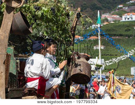 ESTREITO DE CAMARA DE LOBOS PORTUGAL - SEPTEMBER 10 2016: Two children wearing in traditional costumes at Madeira Wine Festival in Estreito de Camara de Lobos Madeira Portugal. The Madeira Wine Festival honors the grape harvest with a celebration of tradi