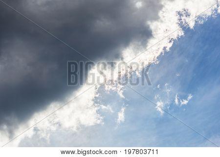 Dark cloud covers the blue sky diagonal composition