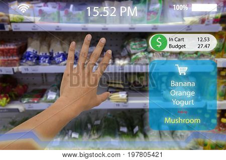 internet of things iotman hand try to pick the product in to the cart with augmented reality technology with virtual reality display screen which show the product and subtotal in the retail or store