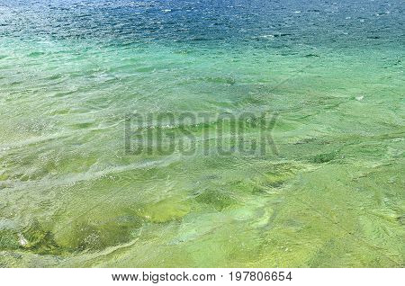 Water in the lake of Plitvice National Park. Close-up.