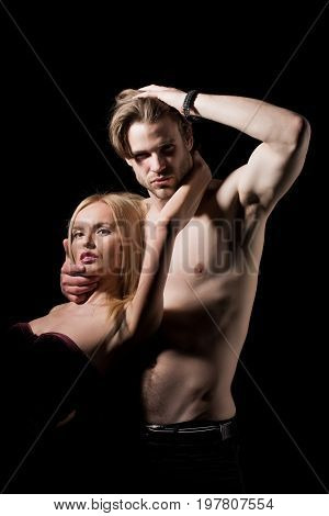 Couple in love of sexy man and woman. Relations of girl and guy. Boyfriend and girlfriend on black. Man with muscular body with sexy girl. Love and romance.